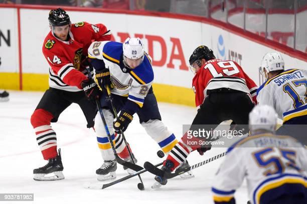 St Louis Blues left wing Alexander Steen battles with Chicago Blackhawks defenseman Jan Rutta and Chicago Blackhawks center Jonathan Toews for a...