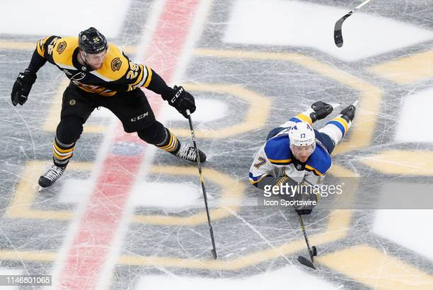 St Louis Blues left wing Jaden Schwartz moves the puck away from Boston Bruins right defenseman Brandon Carlo during Game 1 of the 2019 Stanley Cup...