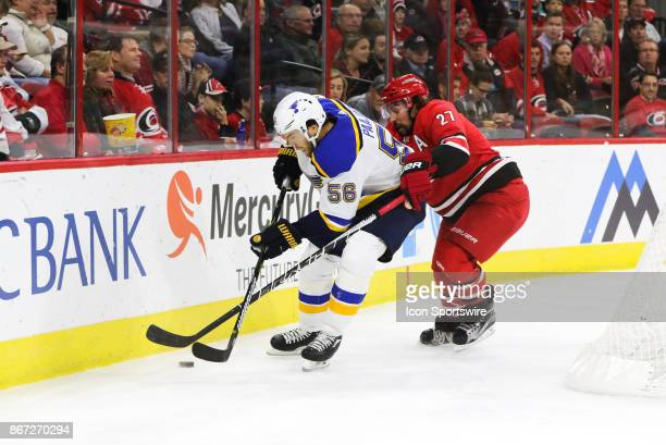 St Louis Blues Left Wing Magnus Paajarvi and Carolina Hurricanes Defenceman Justin Faulk during the 2nd period of the Carolina Hurricanes game versus...