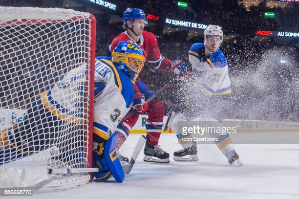 St Louis Blues left wing Vladimir Sobotka and Montreal Canadiens defenseman Jeff Petry battle for position in front of St Louis Blues goalie Jake...