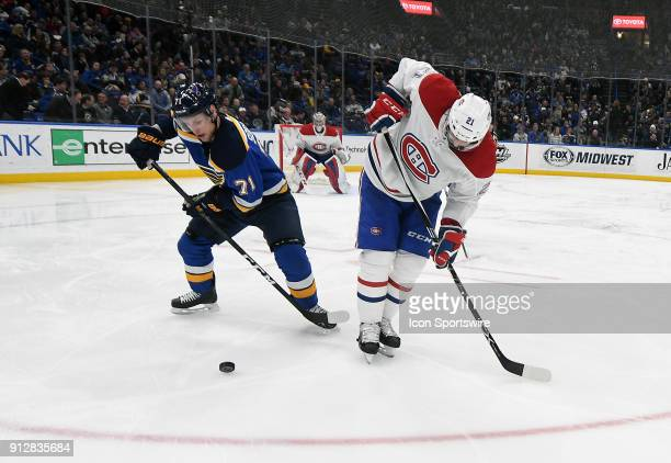 St Louis Blues left wing Vladimir Sobotka and Montreal Canadiens defenseman David Schlemko compete for the puck during an NHL game between the...