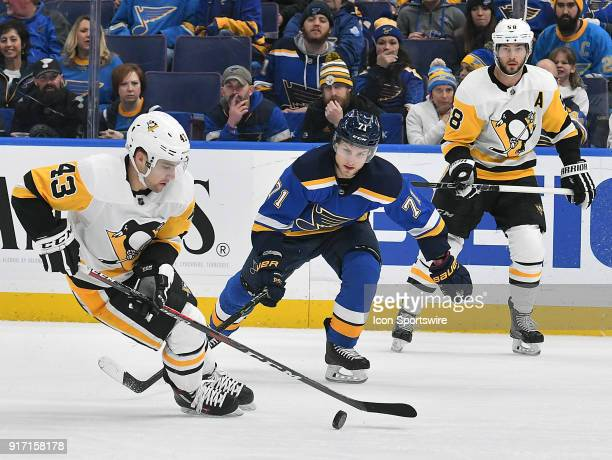 St Louis Blues left wing Vladimir Sobotka challenges Pittsburgh Penguins leftwing Conor Sheary for the puck during a NHL game between the Pittsburgh...