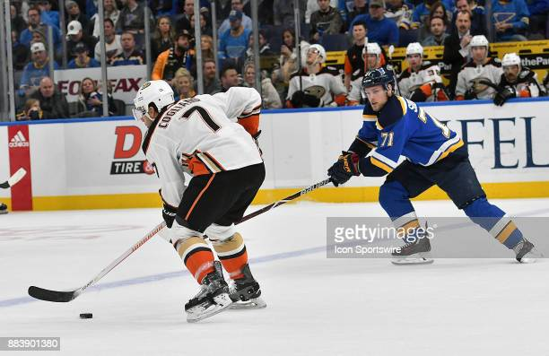 St Louis Blues left wing Vladimir Sobotka reaches in to knock the puck away from Anaheim Ducks leftwing Andrew Cogliano during a NHL game between the...