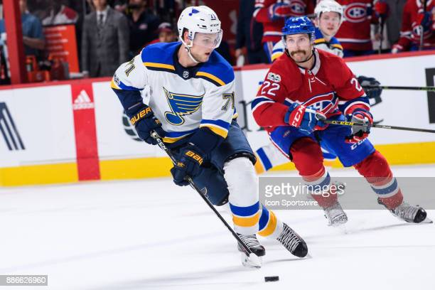 St Louis Blues left wing Vladimir Sobotka skates with the puck while being chased by Montreal Canadiens defenseman Karl Alzner during the third...