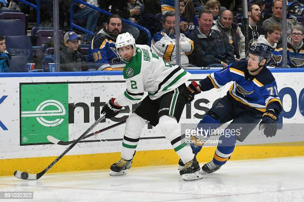 St Louis Blues left wing Vladimir Sobotka tries to knock the puck away from Dallas Stars defenseman Dan Hamhuis during a NHL game between the Dallas...