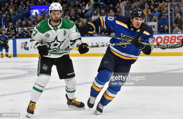 St Louis Blues leftwing Alexander Steen charges after the puck as Dallas Stars rightwing Alexander Radulov looks on during a NHL game between the...