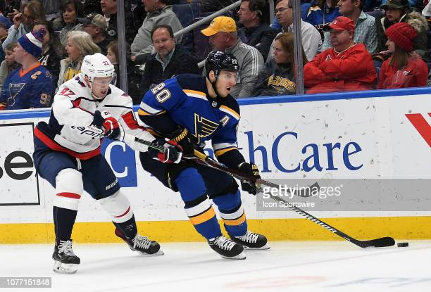 St. Louis Blues leftwing Alexander Steen skates with the puck ahead of Washington Capitals center Evgeny Kuznetsov during an NHL game between the...