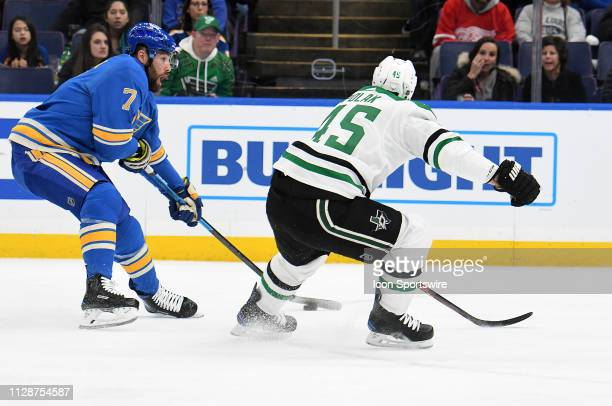 St Louis Blues leftwing Pat Maroon skates with the puck with pressure from Dallas Stars defenseman Roman Polak during an NHL game between the Dallas...