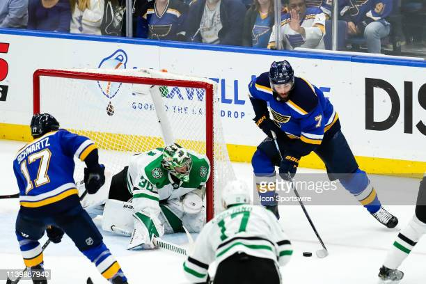 St Louis Blues' Pat Maroon right looks to make a move with the puck in front of Dallas Stars goaltender Ben Bishop during the second period of Game 2...