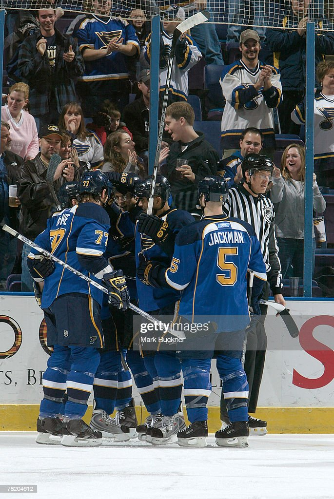 St Louis Blues Players Celebrate A Goal Against The Chicago Blackhawks On December 1