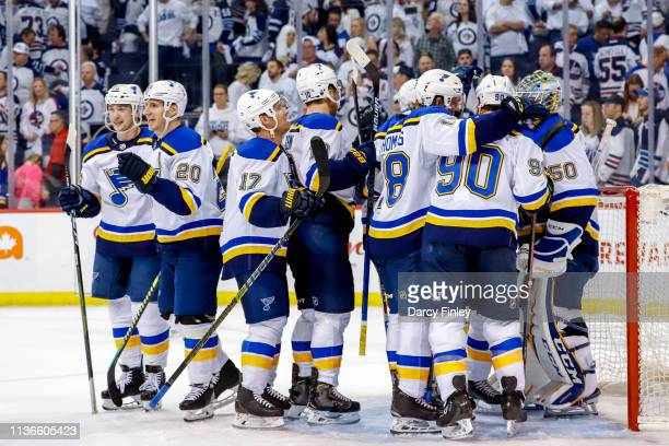 St Louis Blues players celebrate following a 43 victory over the Winnipeg Jets in Game Two of the Western Conference First Round during the 2019 NHL...