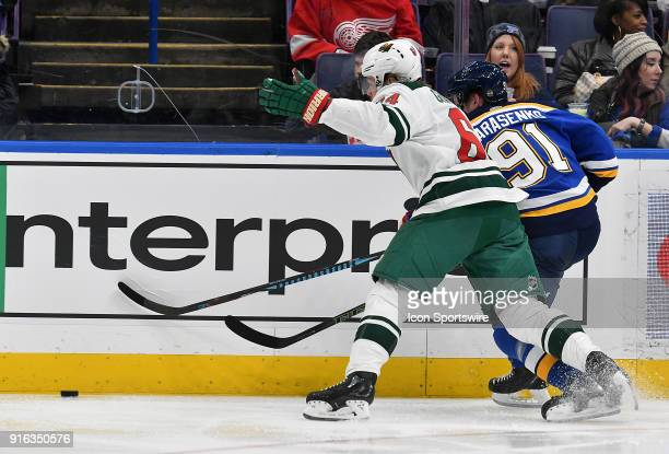 St Louis Blues right wing Vladimir Tarasenko and Minnesota Wild rightwing Mikael Granlund chase down a loose puck during an NHL game between the...