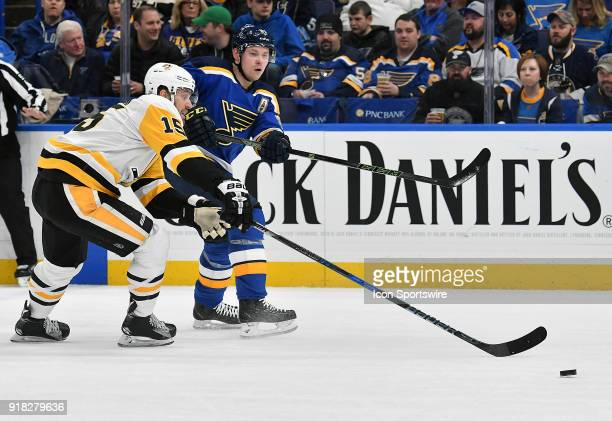 St Louis Blues right wing Vladimir Tarasenko and Pittsburgh Penguins center Riley Sheahan go after a loose puck during a NHL game between the...