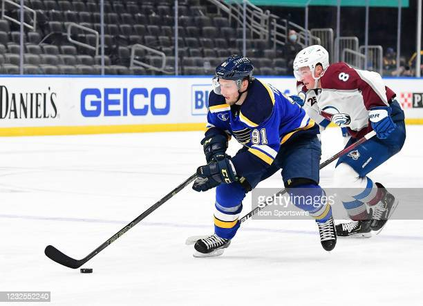 St. Louis Blues right wing Vladimir Tarasenko controls the puck ahead of Colorado Avalanche defenseman Cale Makar during a NHL game between the...