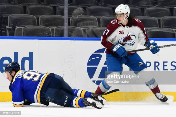 St. Louis Blues right wing Vladimir Tarasenko falls to the ice while Colorado Avalanche defenseman Ryan Graves looks on during a NHL game between the...