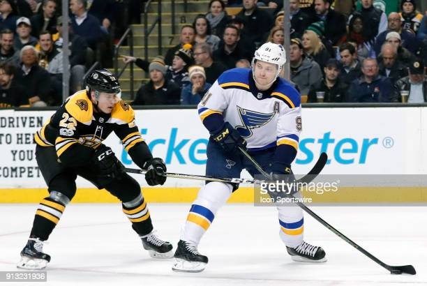 St Louis Blues right wing Vladimir Tarasenko looks to pass as Boston Bruins left wing Peter Cehlarik moves in during a game between the Boston Bruins...