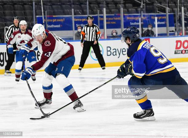 St. Louis Blues right wing Vladimir Tarasenko reaches in to get the puck from Colorado Avalanche left wing Valeri Nichushkin during a NHL game...