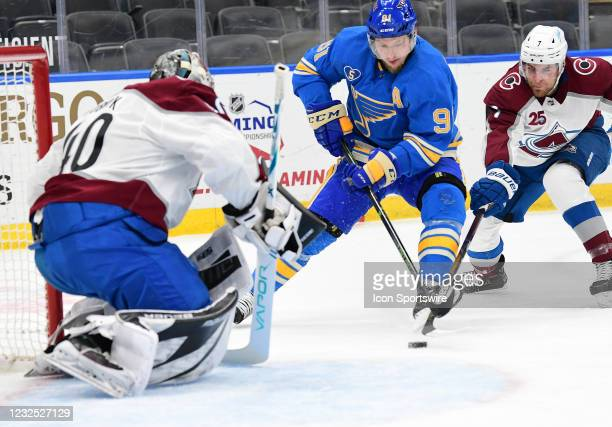 St. Louis Blues right wing Vladimir Tarasenko sets up a shot on goal with pressure from Colorado Avalanche defenseman Devon Toews during a NHL game...