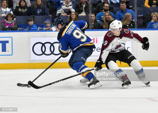 St Louis Blues right wing Vladimir Tarasenko skates with the puck ahead of Colorado Avalanche defenseman Samuel Girard during a NHL game between the...