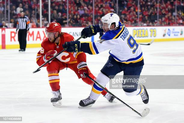 St Louis Blues Right Wing Vladimir Tarasenko takes a shot as Calgary Flames Right Wing Elias Lindholm tries to block the puck during an NHL game...