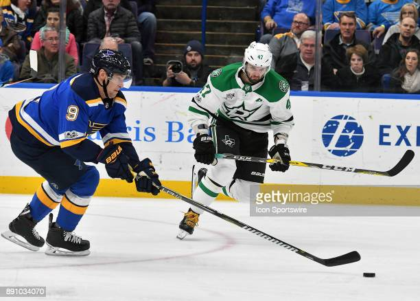 St Louis Blues rightwing Scottie Upshall and Dallas Stars rightwing Alexander Radulov go after a loose puck during a NHL game between the Dallas...
