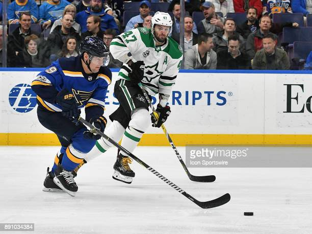 St Louis Blues rightwing Scottie Upshall and Dallas Stars rightwing Alexander Radulov compete for a loose puck during a NHL game between the Dallas...