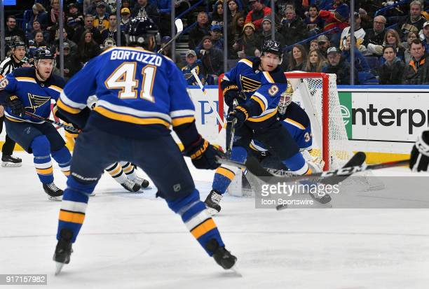 St Louis Blues rightwing Scottie Upshall clears the puck from the Blues' goal during a NHL game between the Pittsburgh Penguins and the St Louis...
