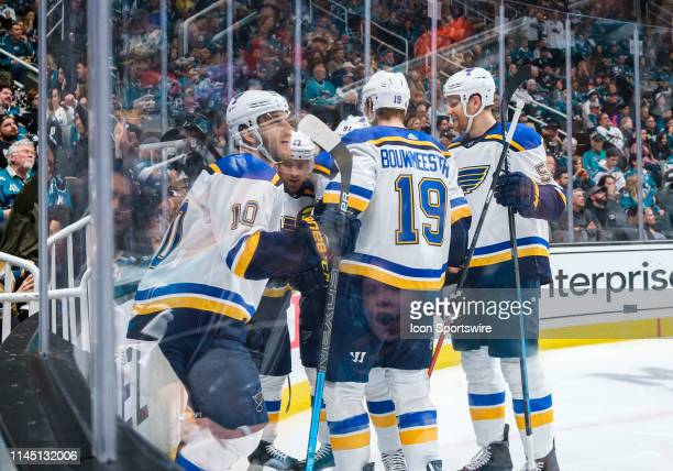 St Louis Blues teammates congratulate St Louis Blues left wing Jaden Schwartz on his score during the 5th game of the Western Conference Final...