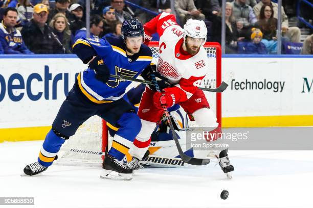 St Louis Blues' Vladimir Sobotka left battles for a loose puck with Detroit Red Wings' Henrik Zetterberg during the second period of an NHL hockey...