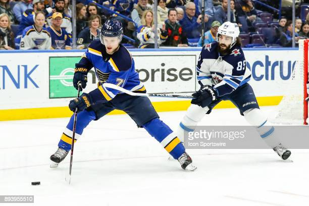 St Louis Blues' Vladimir Sobotka left controls the puck while under pressure from Winnipeg Jets' Mathieu Perreault during the third period of an NHL...