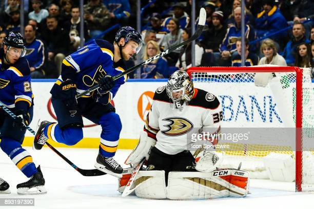 St Louis Blues' Vladimir Sobotka left leaps out of the way of a shot from the point as Anaheim Ducks goalie John Gibson makes a save during the...