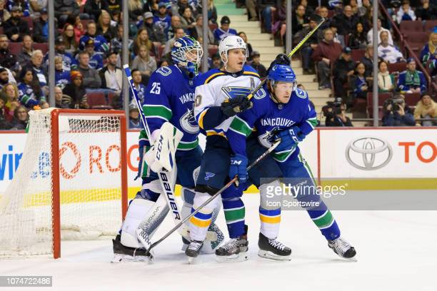 St Louis Blues Winger Alexander Steen screens Vancouver Canucks Goaltender Jacob Markstrom while Right wing Brock Boeser defends during their NHL...