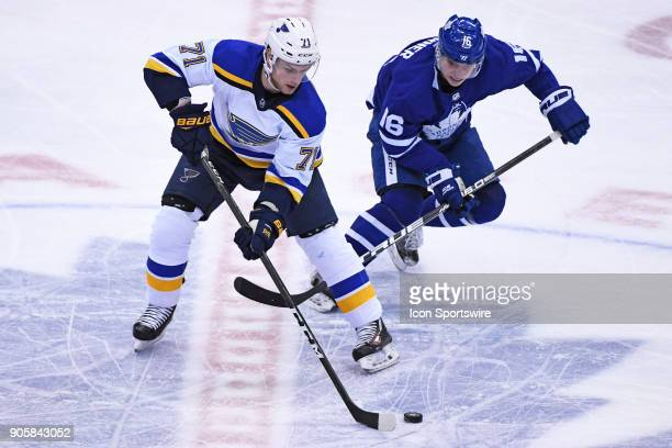 St Louis Blues Winger Vladimir Sobotka and Toronto Maple Leafs Right Wing Mitchell Marner fight for the puck during the regular season NHL game...