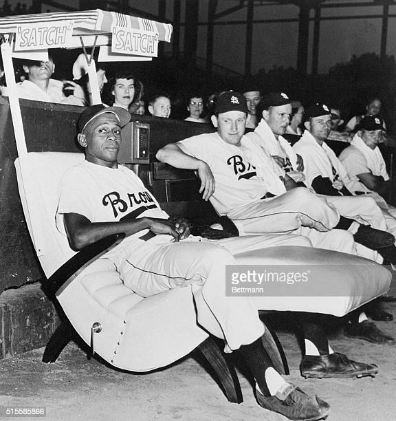 """St. Louis Browns' relief pitcher Leroy """"Satchel"""" Paige, a star pitcher in the Negro Leagues for many years, relaxes in a new easy chair in the..."""
