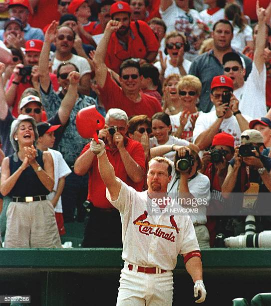 St Louis Cardinal first baseman Mark McGwire salutes the fans at Busch Stadium after hitting his 70th home run of the season in the seventh inning...