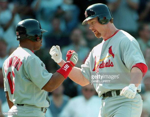 St Louis Cardinal Mark McGwire receives congratulations from teammate Ray Lankford after McGwire hit his gamewinning and league leading fortyninth...