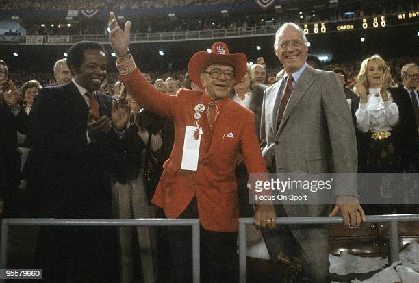 St Louis Cardinal owner Gussie Busch waving to the crowd standing next to Baseball commissioner Bowie Kuhn and singer Lou Rawls before a 1982 world...