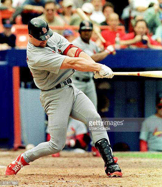 St. Louis Cardinal slugger Mark McGwire slams his 50th home run of the year off New York Mets reliever Jeff Tam in the seventh inning of their game...