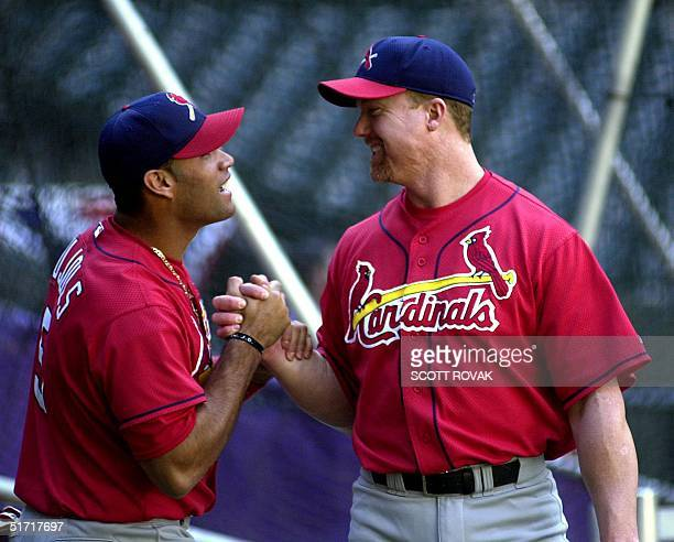 St Louis Cardinals' Albert Pujols and slugger Mark McGwire speak during workouts at Bank One Ballpark in Phoenix Arizona 08 October 2001 The...
