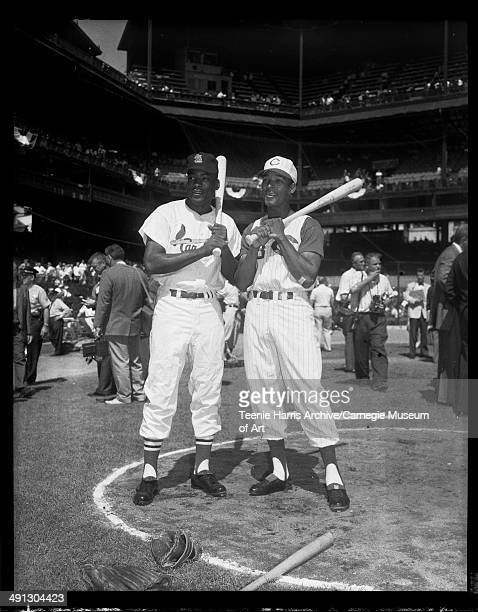 St Louis Cardinals baseball player Bill White and Cincinnati Reds center fielder no 28 Vada Pinson, posing with bats during 1959 All Star Game,...