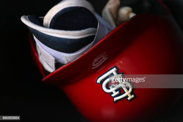 St Louis Cardinals' batting helmet and shin guards in the dugout before a spring training game against the Houston Astros at FITTEAM Ball Park of the...