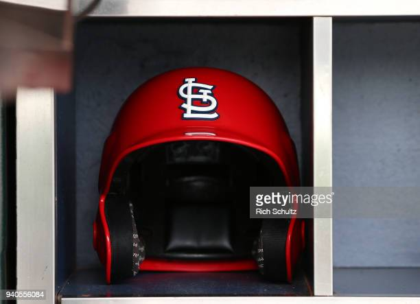 St Louis Cardinals batting helmet in the dugout before a game against the New York Mets at Citi Field on March 29 2018 in the Flushing neighborhood...