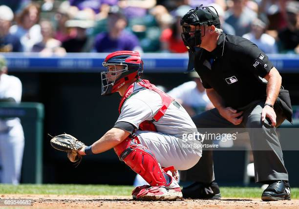 St. Louis Cardinals Catcher, Eric Fryer and home plate umpire, Ted Barrett during a regular season MLB game between the Colorado Rockies and the...