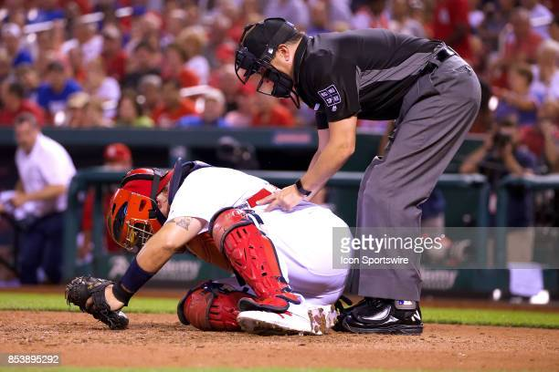 St Louis Cardinals catcher Yadier Molina gets hit by a foul tip in the top of the 7th inning against the Chicago Cubs during a MLB baseball game...