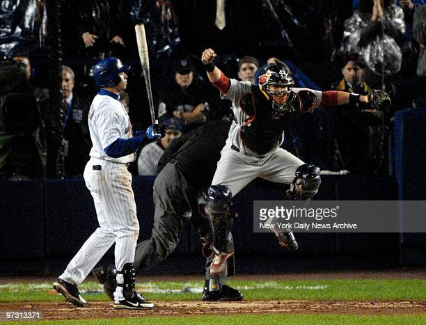 St. Louis Cardinals' catcher Yadier Molina rejoices after New York Mets' Carlos Beltran strikes out looking in the ninth inning to end Game 7 of the...