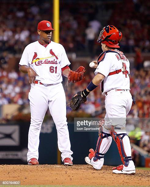 St Louis Cardinals catcher Yadier Molina walks a ball out to pitcher Alex Reyes during the fifth inning of a baseball game against the Chicago Cubs...