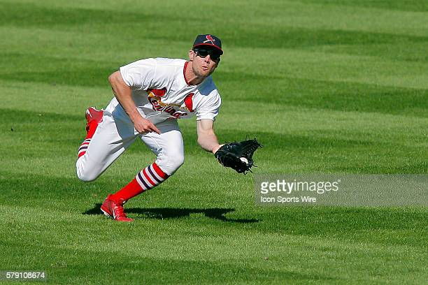 St Louis Cardinals center fielder Peter Bourjos catches for an out during the seventh inning of a baseball game against the Colorado Rockies at Busch...