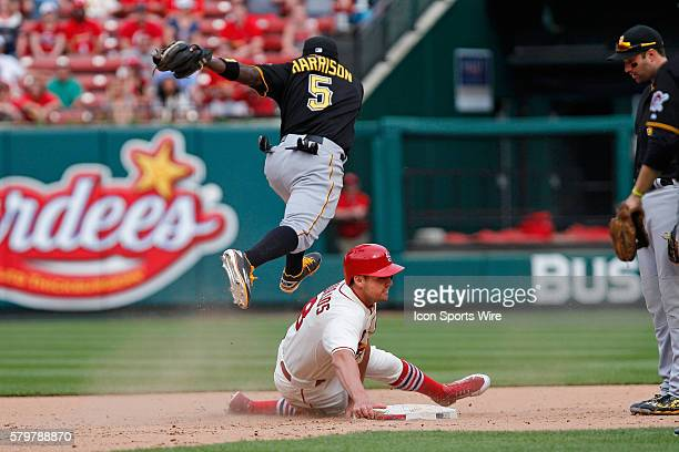 St Louis Cardinals center fielder Peter Bourjos get caught in a run down and is tag out by Pittsburgh Pirates third baseman Josh Harrison during the...