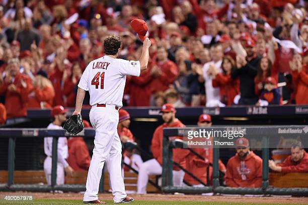 St Louis Cardinals fans applaud as John Lackey of the St Louis Cardinals walks off the field in the eighth inning against the Chicago Cubs during...