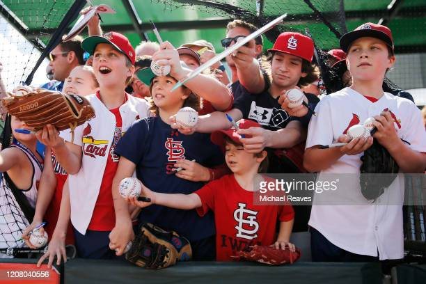St Louis Cardinals fans wait for autographs prior to a Grapefruit League spring training game against the New York Mets at Roger Dean Stadium on...